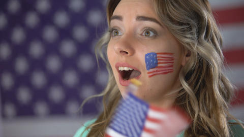 Happy American girl cheering with smile on face, supporting candidate, elections Footage