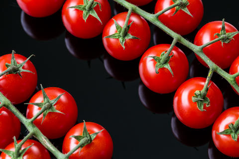 Fresh cherry tomatoes on a black background Photo