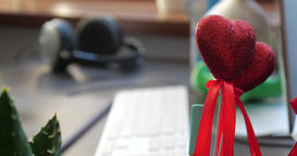Red heart on the stick in the office Archivo