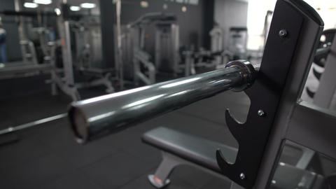 Gym worker adding weight plate barbell, checking equipment, high quality service Footage