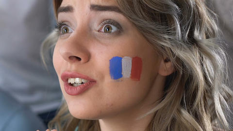 Female France fan watching football match, celebrating goal, supporting team Footage
