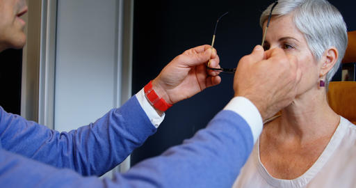 Optometrist adjusting eyeglasses on patient eyes 4k Live Action