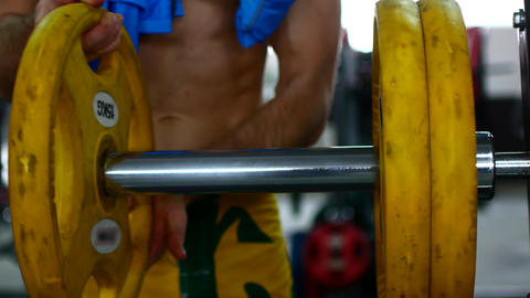 Closeup macro close up of handsome bodybuilder guy prepare to do exercises with 영상물