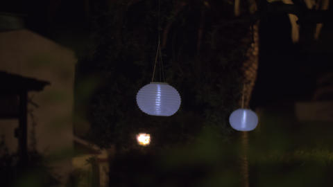 House garden with white paper lanterns at night Live Action