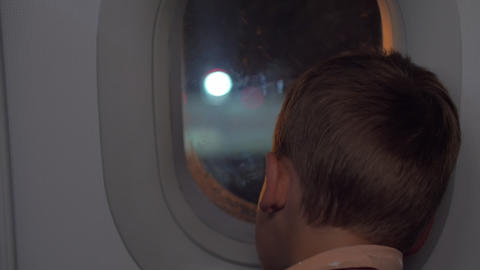 Child in plane arriving to the airport at night Live Action