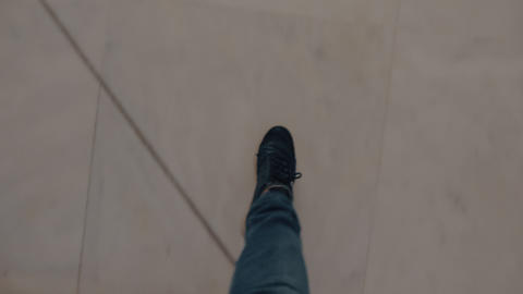 Male feet going down a marble steps Stock Video Footage