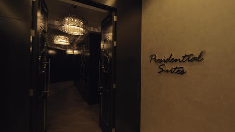 Hallway leading to presidential suites in hotel Live Action