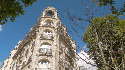 Exterior of baroque style corner building in Paris, France Live Action