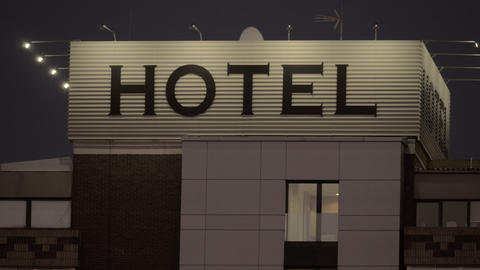 Night view of hotel banner in the street Footage
