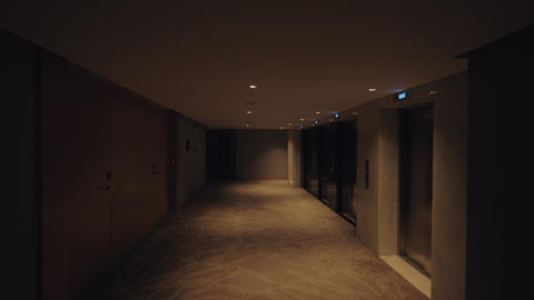 Walking in hotel hallway, view in dim light Footage