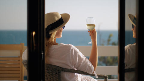 Woman relaxing in solitude. She drinking wine and enjoying sea view Footage