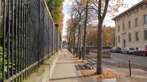 Paris view in autumn. Walking along the quiet street Footage