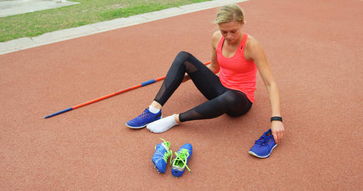 Front view of Caucasian female athlete wearing sport shoes at sport venue 4k Live Action