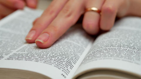Woman's Hands Open The Book On Table And Find Information GIF