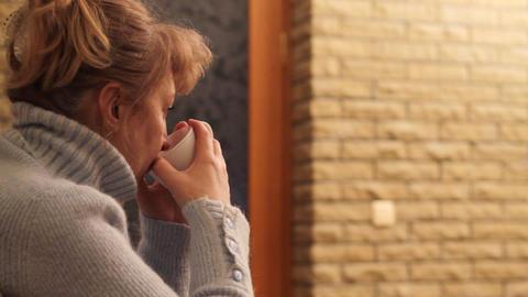 woman drinks tea Stock Video Footage