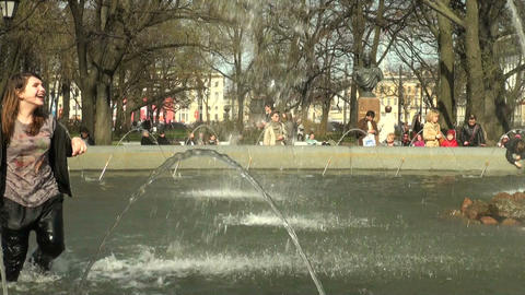 Girls bathe in the fountain Stock Video Footage