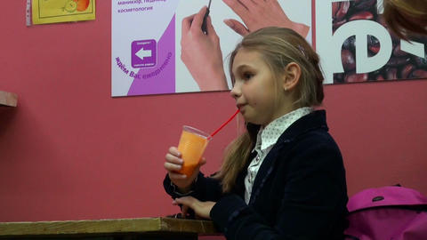 Girl drinking juice Stock Video Footage