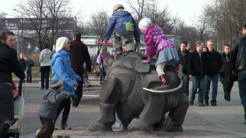 Children climb on sculpture Stock Video Footage