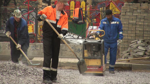 Workers are pavings street Stock Video Footage