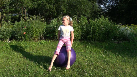 The girl jumped on the ball Stock Video Footage