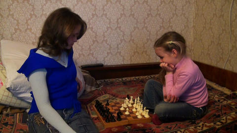 mother daughter play chess Stock Video Footage