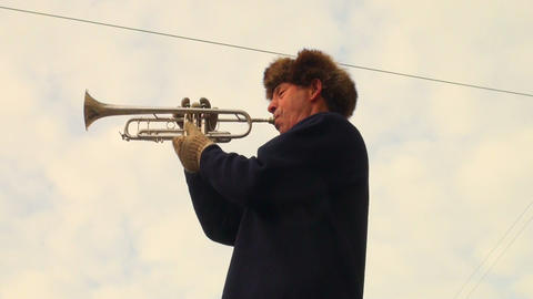 Trumpeter playing in the street Footage