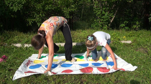 The mother with her daughter play twister Stock Video Footage