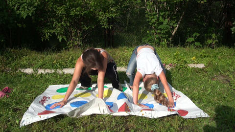 The mother with her daughter play twister Footage