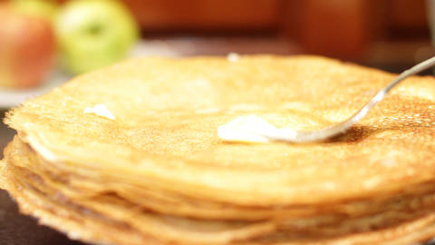 female hand oils pancakes Stock Video Footage