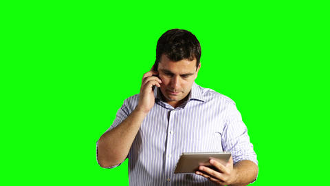 Young Businessman Tablet OC and Cell Phone Greenscreen 43 Footage