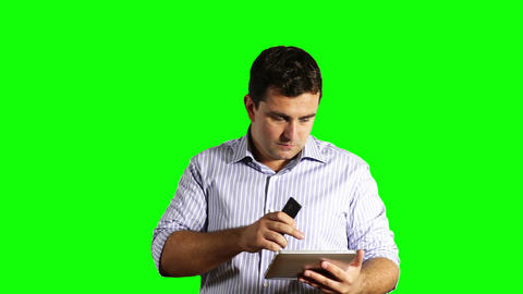 Young Businessman Tablet OC and Cell Phone Greenscreen 43 Stock Video Footage