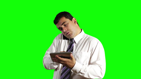 Young Businessman Tablet PC and Cell Phone Greenscreen 7 Footage