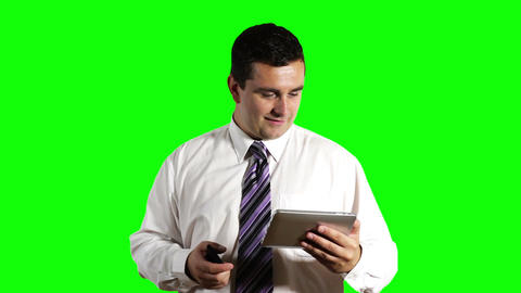 Young Businessman Tablet PC and Cell Phone Greenscreen 10 Footage