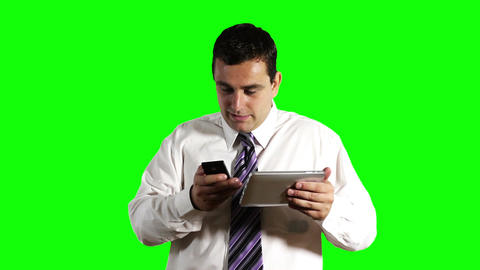 Young Businessman Tablet PC and Cell Phone Greenscreen 12 Stock Video Footage