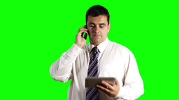 Young Businessman Tablet PC and Cell Phone Greenscreen 14 Stock Video Footage