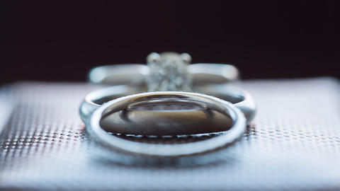Wedding rings with diamonds closeup footage Footage