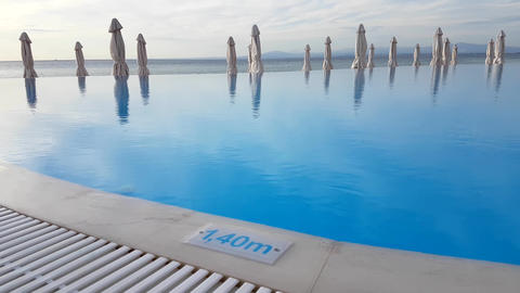 An infinity pool at a hotel, with depth sign Live Action