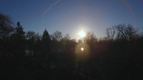 Flying over Buen Retiro Park in Madrid, Spain. Winter view with shining sun Footage