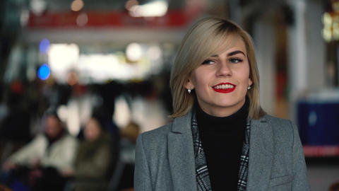 Portrait of a beautiful blonde girl with red lips Footage