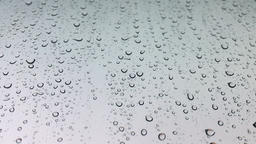 Transparent Water Droplets on White Surface Live Action