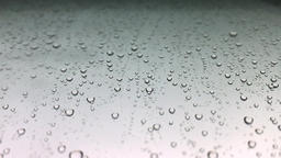 Clear Water Droplets on White Surface Live Action