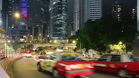 Night Traffic between the Skyscrapers of Hong Kong. Fast Motion Footage