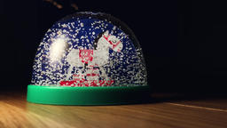 Christmas Snow Globe With Flakes Falling Archivo