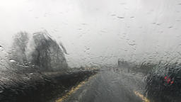 Wet Windshield Window of a Moving Car on a Highway Footage