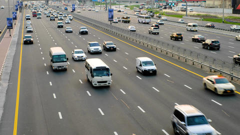Cars run along widest Sheikh Zayed highway. High angle perspective, top view on Live Action