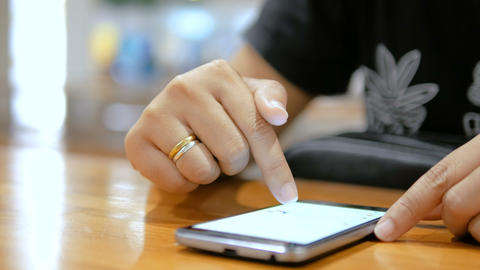 Close up shot hands of woman using smartphone select focus shallow depth of ビデオ