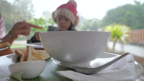 Hot soup steam against Asian little girl in the winter time select focus shallow ビデオ
