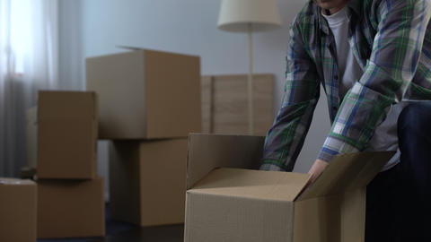 Man packing things moving out from house, labor migration abroad, life changes Footage
