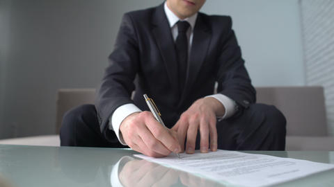 Man signing document, happy businessman receiving big loan from bank and smiling Live Action