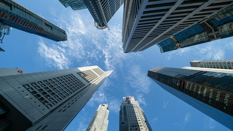 Looking up to high-rise buildings, skyscrapers, architectures in smart city for Footage